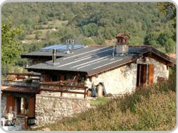 Hut with solar panels and fireplace