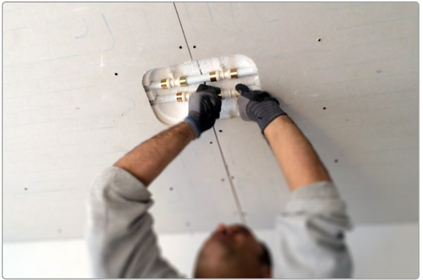 Installing radiant ceiling panels